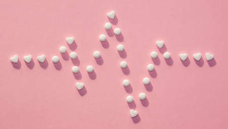 The figures of pills on a Colored background