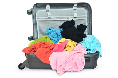 Open suitcase with clothing
