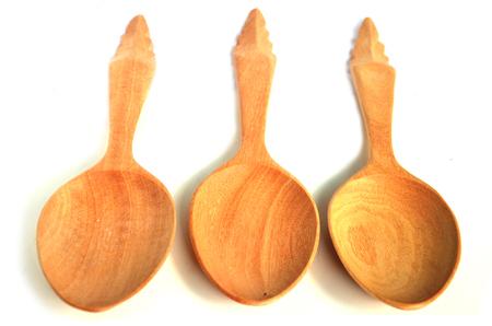 Asian vintage wooden spoon on white background photo
