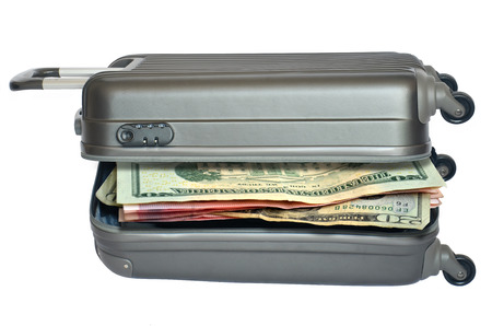 Money of travel suitcase full of banknotes