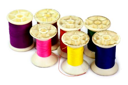 lurex: bobbins of lurex thread on white background Stock Photo