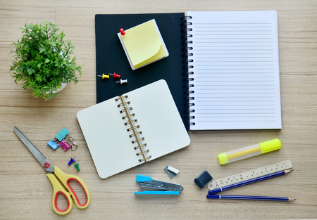 Background blank paper and office tools on the wood table - Top view photo