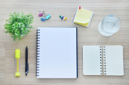 Background : blank paper and office tools on the wood table - Top view photo
