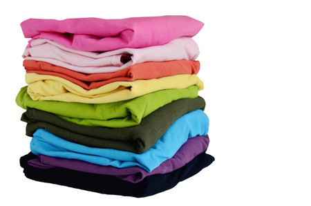 folded: Pile of colorful clothes, isolated white background