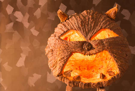 hollows: Halloween pumpkin with a light to the left, into the shadows Stock Photo