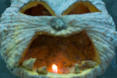hollows: Halloween pumpkin with a light into the shadows, blur. Stock Photo