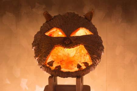 hollows: Halloween pumpkin with a light into the shadows,dark tone Stock Photo