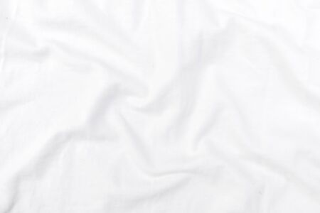 Abstract white fabric texture background. Wavy white cloth.