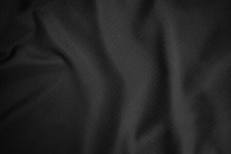 Background texture black cloth. Abstract dark wavy soft. Fabric is wrinkled. Fashion luxury style. Imagens