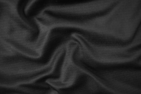 Background texture black cloth. Abstract dark wavy soft. Fabric is wrinkled. Fashion luxury style. Stock fotó