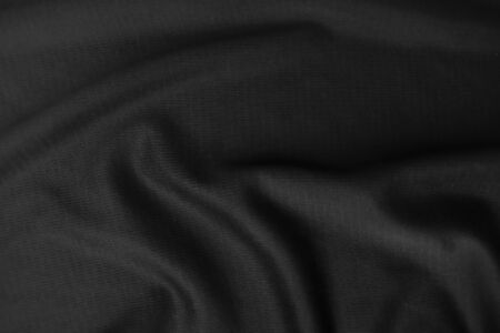 Background texture black cloth. Abstract dark wavy soft. Fabric is wrinkled. Fashion luxury style.