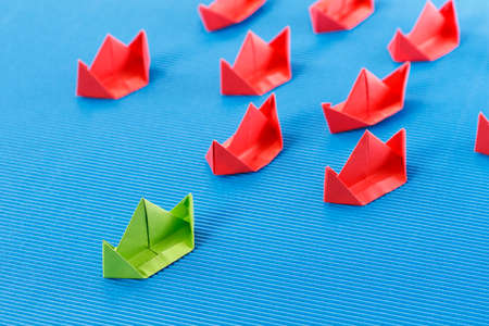 business innovation: Paper boat in ocean. Blue ocean marketing concept. Stock Photo