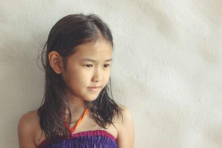 gir: Little asian girl in relex mood Stock Photo