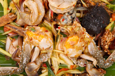 Hot and spicy sour Thai Salads. With Field CRAB and Chopped Mango. Black CRAB. Close Up. Archivio Fotografico