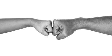 Fist Bump between Man and Boy. ISOLATED On WHITE BACKGROUND. Black And White.