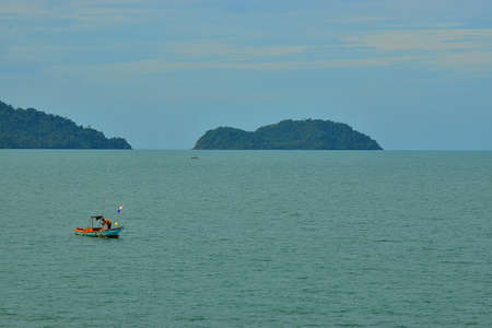 Fishing Boat in the Sea with fisherman