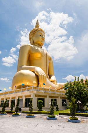 big golden statue image of buddha at Wat muang, Angthong province, Thailand photo