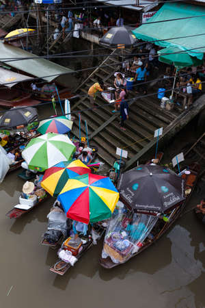 amphawa: boats selling food at Amphawa Floating market, Thailand Editorial