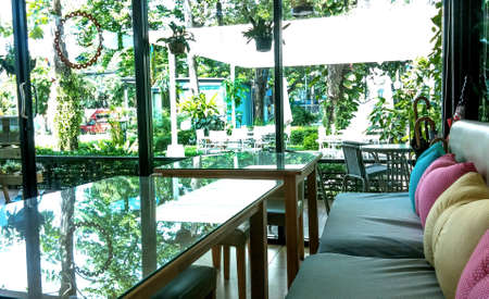 dinning room: Dinning room with reflection of green trees garden