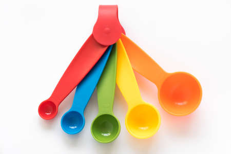 measuring spoons: Colorful measuring spoons on white background