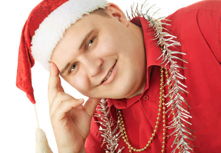 Smiling young man in a red shirt, hat Santa Claus and tinsel in anticipation of the new year. Isolated on white background photo