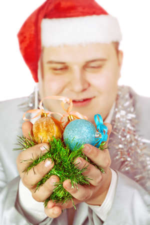 Young man holds Christmas toys. Isolated on white background.Soft focus. Stock Photo - 11768590