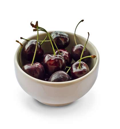 White mug filled with black cherries Stock Photo