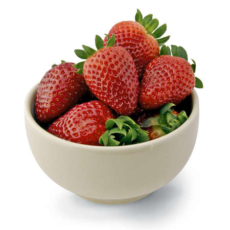 White bowl filled with delicious strawberries Stock Photo