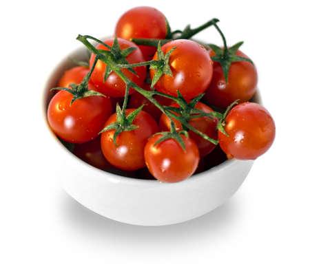 Cherry tomatoes in white cup photo