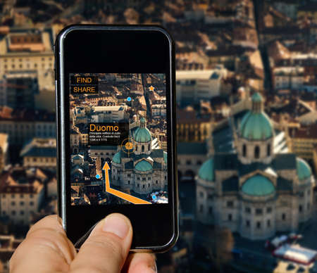 Mobile phone with map app and street indications Stock Photo - 20338157