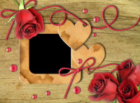 Vintage photo frames, red roses and heart on an old, cracked background       photo