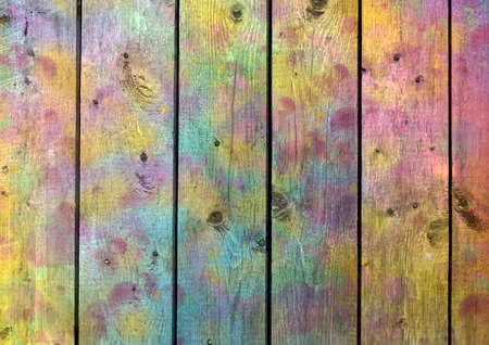 Rainbow wooden planks. The texture of the tree with varicolored spots photo
