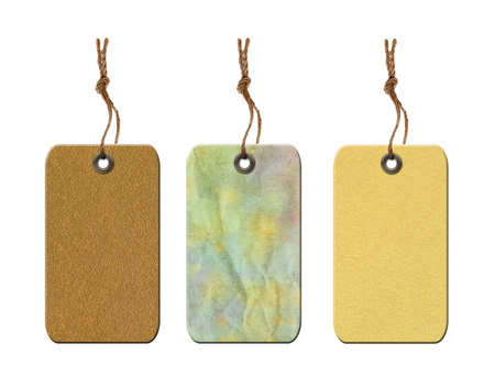 gold string: Vintage blank gift tags with string isolated on white background.