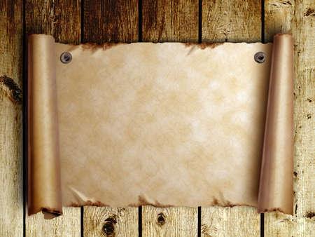 Scroll van oud papier is bevestigd met nagels op houten planken Stockfoto
