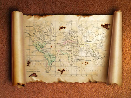ancient scroll map with curled edges, on the old rusty background       photo