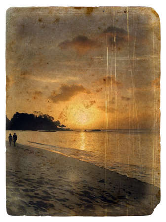Sunset, Seychelles. Old postcard, design in grunge and retro style photo