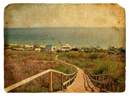 A staircase leads down to the sea. Old postcard, design in grunge and retro style photo