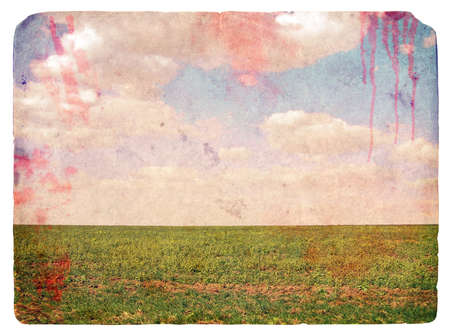 Grunge image of a field and sky with clouds and spots blood. Vintage background photo