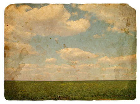 Grunge image of a field and sky with clouds and spots. Vintage background  photo