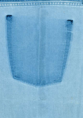 The texture of denim with a trace of the torn pocket photo