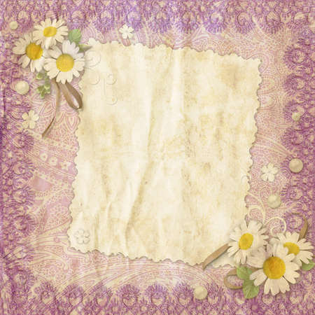vintage background crumpled paper with a border of lace and chamomile flowers photo