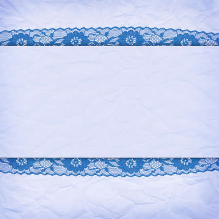 Delicate blue background crumpled paper with a border of lace photo
