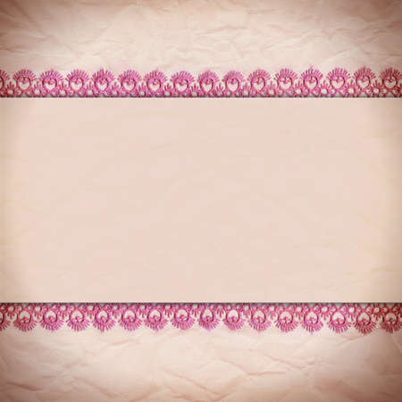Delicate pink background crumpled paper with a border of lace photo