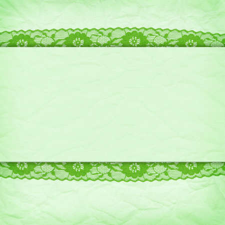 Delicate green background crumpled paper with a border of lace photo