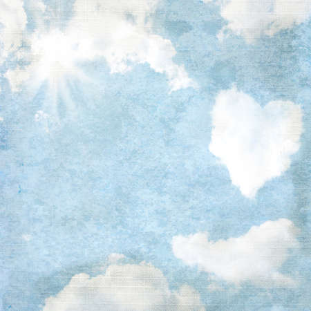 Delicate vintage background - heart-shaped cloud and sun.  photo