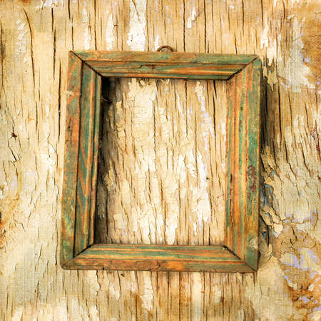 decayed: old photo frame on the cracked wall  Page to design photo books