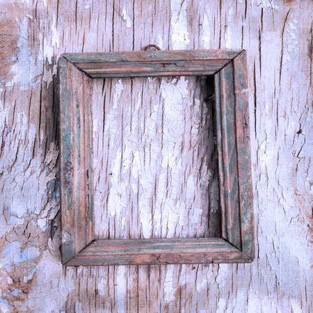 books on a wooden surface: Retro photo frame on the cracked wall  Page to design photo books Stock Photo