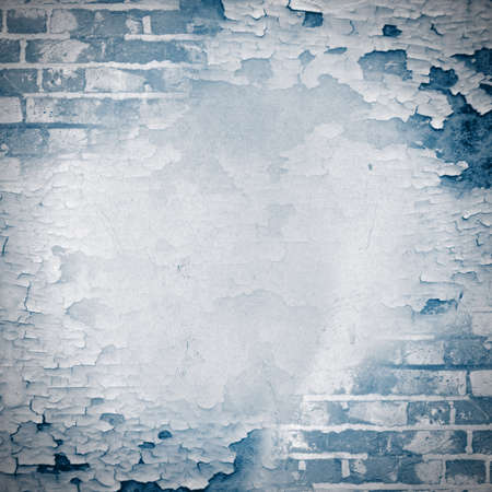 wall paint: Blue square grunge background - cracked paint and brick wall  Page to design photo books Stock Photo