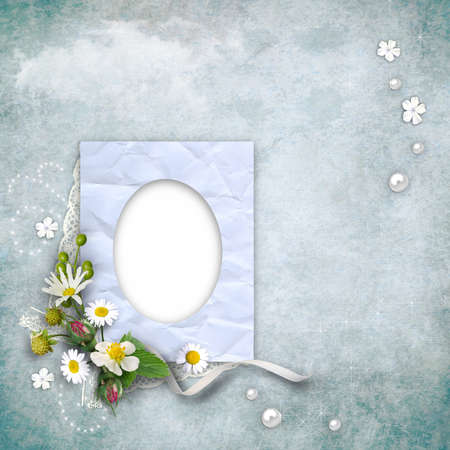 album photo: vintage paper photo frame with flowers on textured background. Page to design photo books