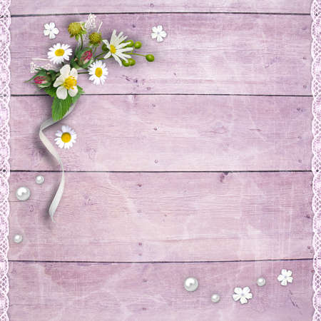 Background page for photo book design. Old wooden planks with a bouquet of flowers and lace